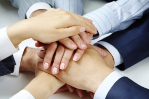 Close –up of business people's hands on top of each other