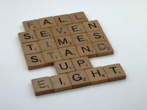 Scrabble tiles that read fall seven times stand up eight